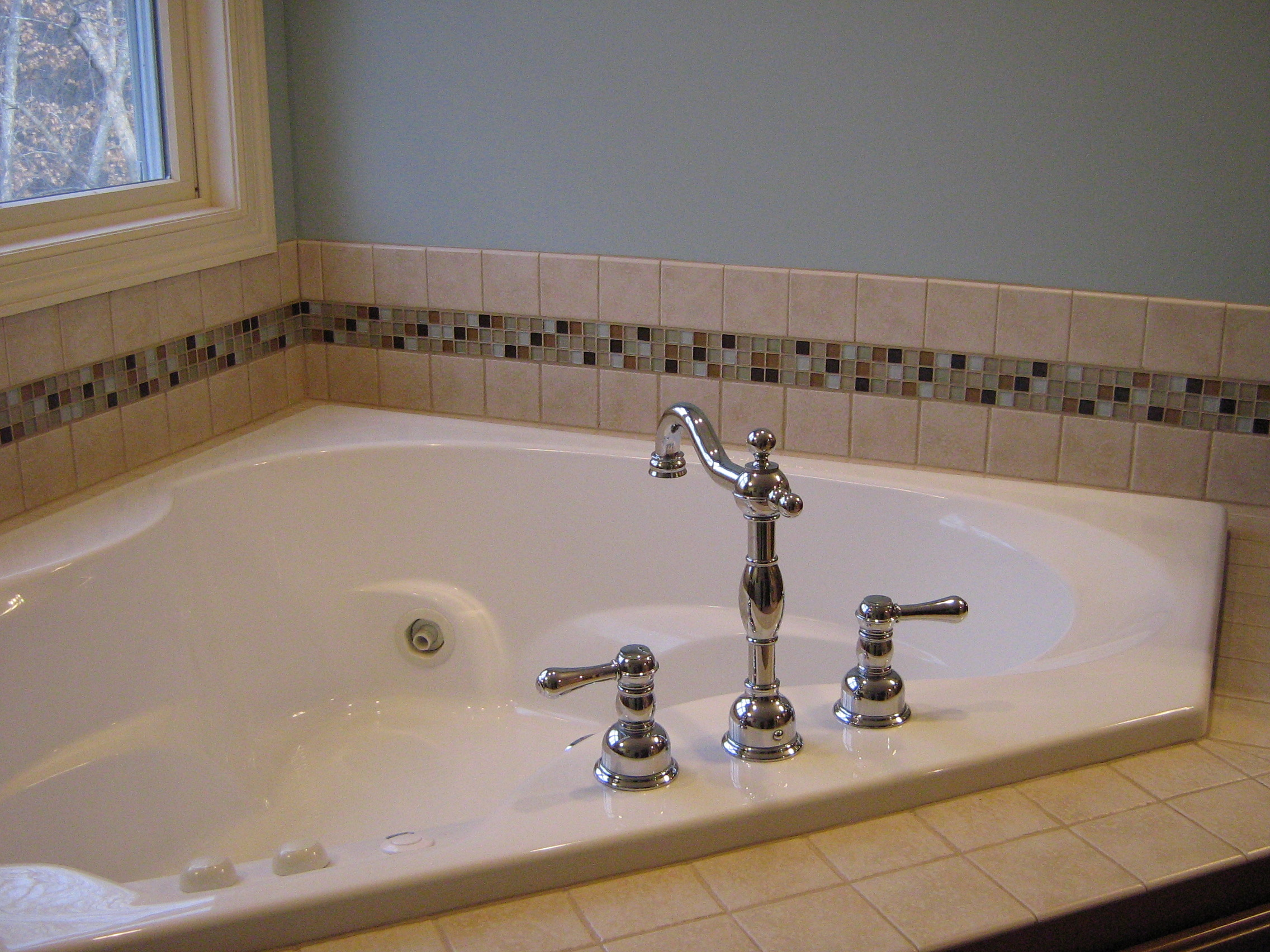 Tile t larsen design llc for Glass tile border bathroom ideas